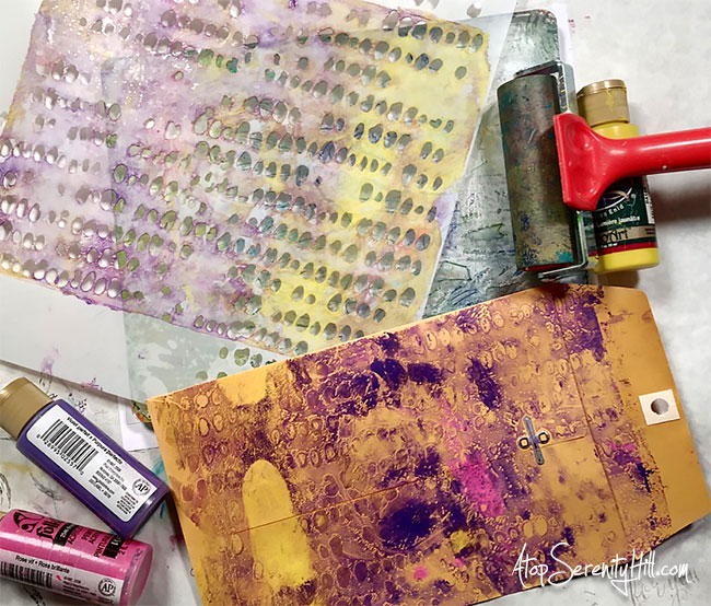 These mail art envelopes have been monoprinted, stenciled, doodled, collaged and painted to create a fun, bright snail mail piece of art! • AtopSerenityHill.com #stencils #mailart #mixedmedia