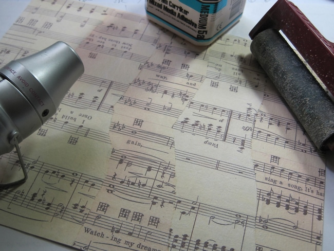 Sheet music adhered to watercolor paper and coated with matte medium