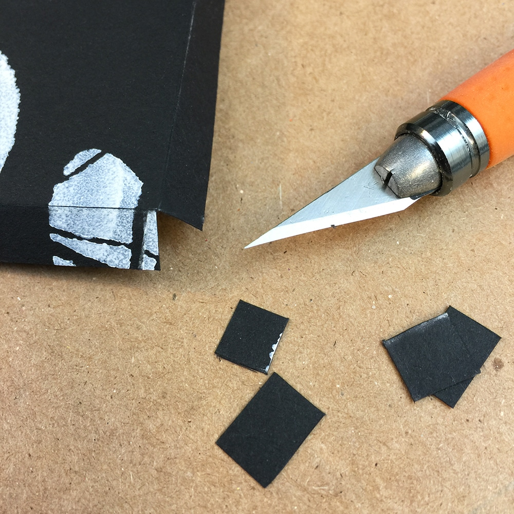 Cut the corners off around each edge of your cover.