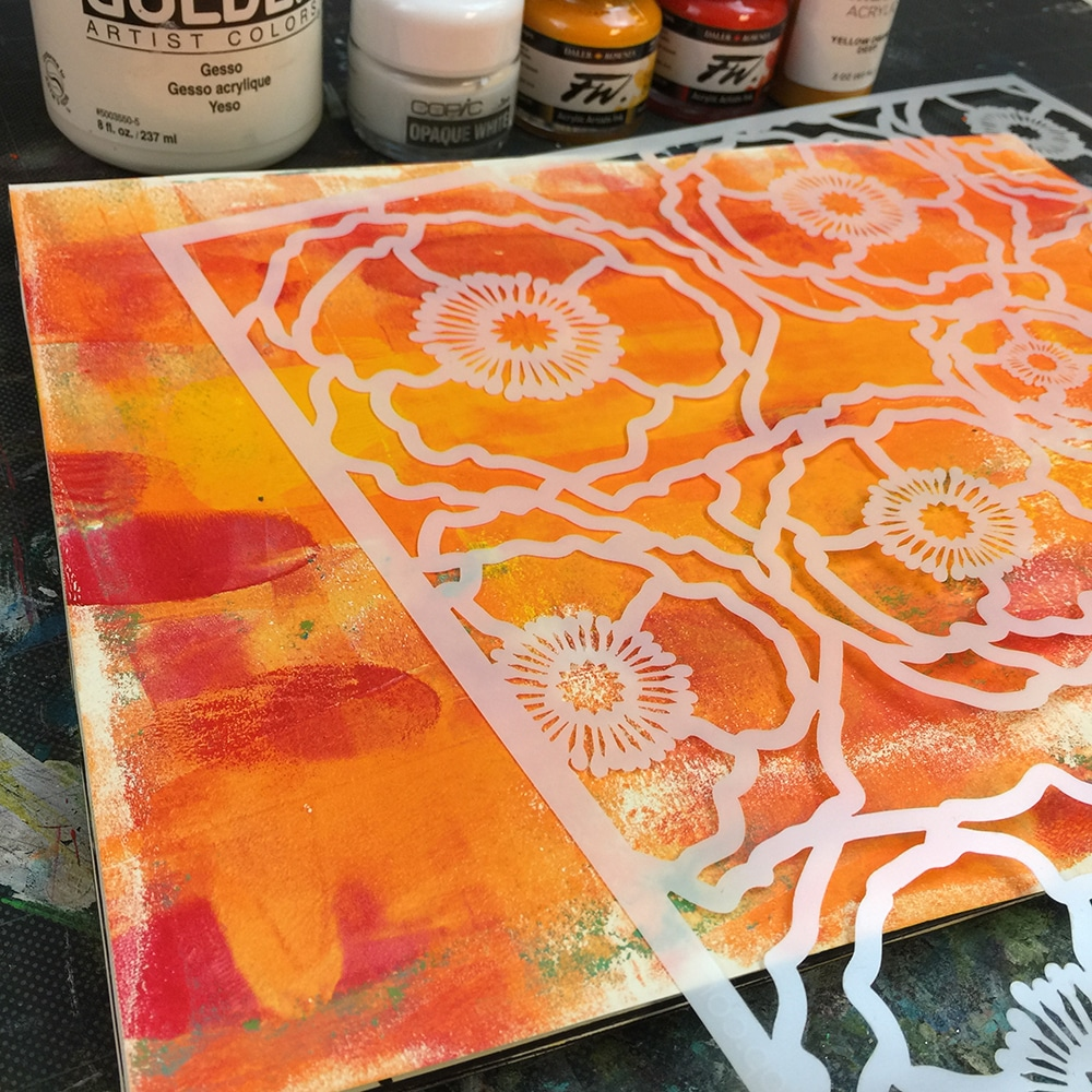 Warm colors to start as my background, inks, gesso and stencil TCW601 Poppy Field