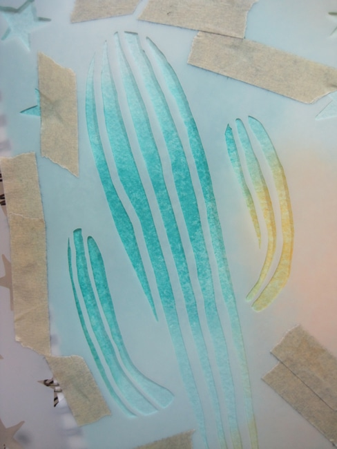 TCW cactus stencil positioned on art journal page LEFKO