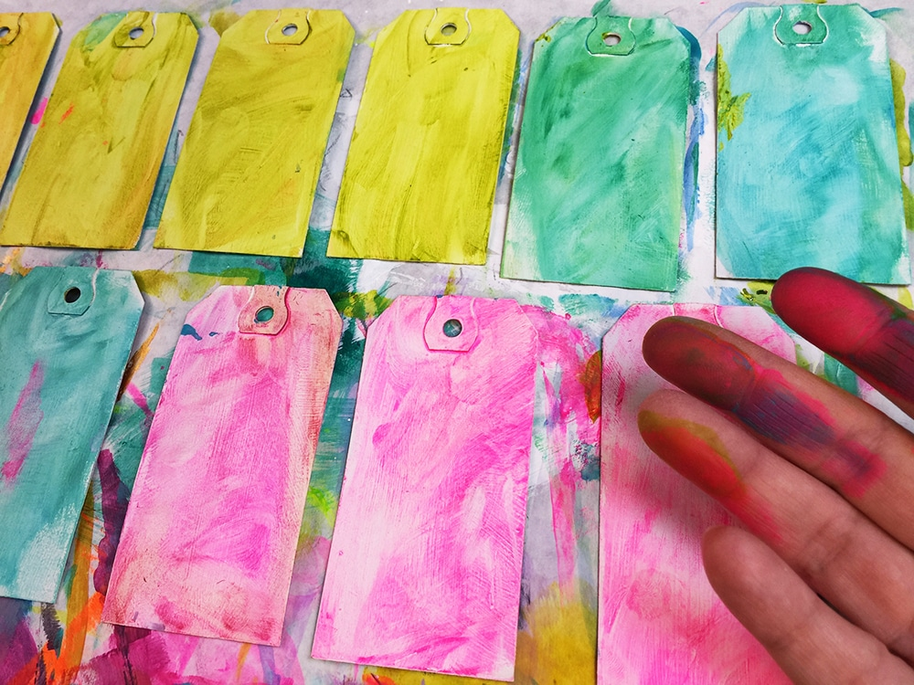 Apply a layer of paint to the tags backs.