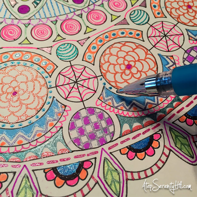 Gel pen mandala using a stencil from The Crafter's Workshop • AtopSerenityHill.com #stencil #mandala #doodling