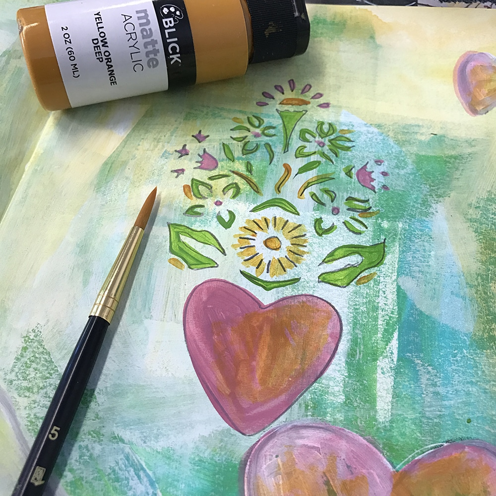 Detail work with acrylic on the stenciled area of your spread