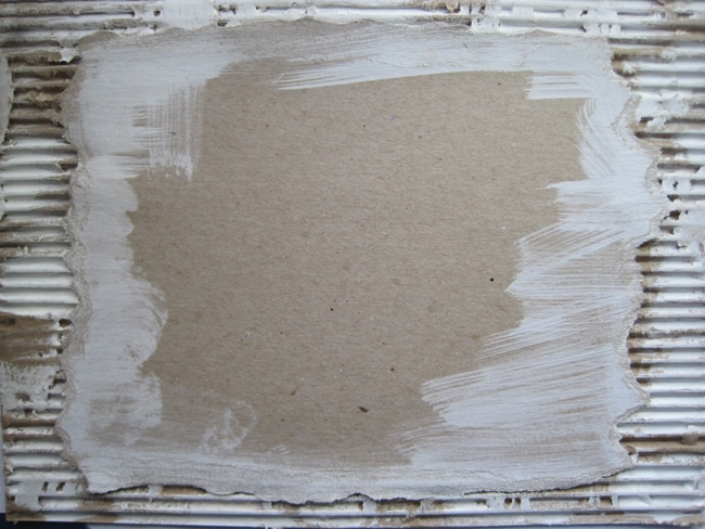 TCW white gesso on cardboard and adhered to corrugated cardboard LEFKO