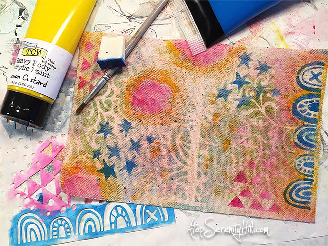 This super cute mini junk journal was created using products from The Crafter's Workshop and Canvas Corp Brands! A fun art journal for all of those mixed media projects! AtopSerenityHill.com