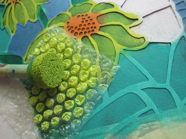 Use bubble wrap and acrylic paints to add design LEFKO