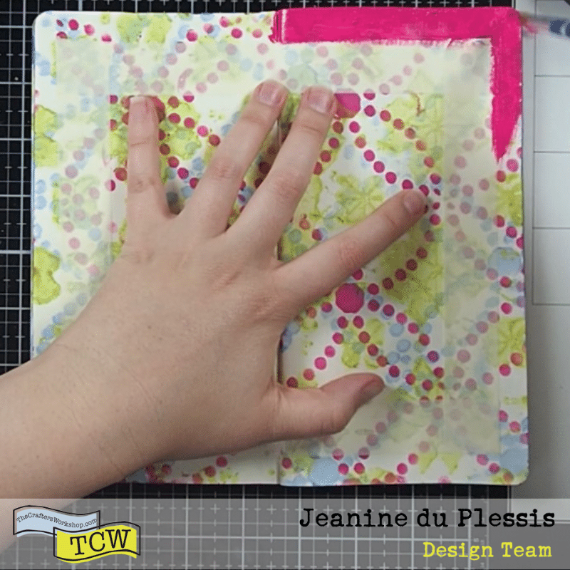 Masking tape around the inner part of the page, exposing a border being painted in Hot Pink.  Pattern from the stenciling still visible. #border #patternpaper #smalljournal