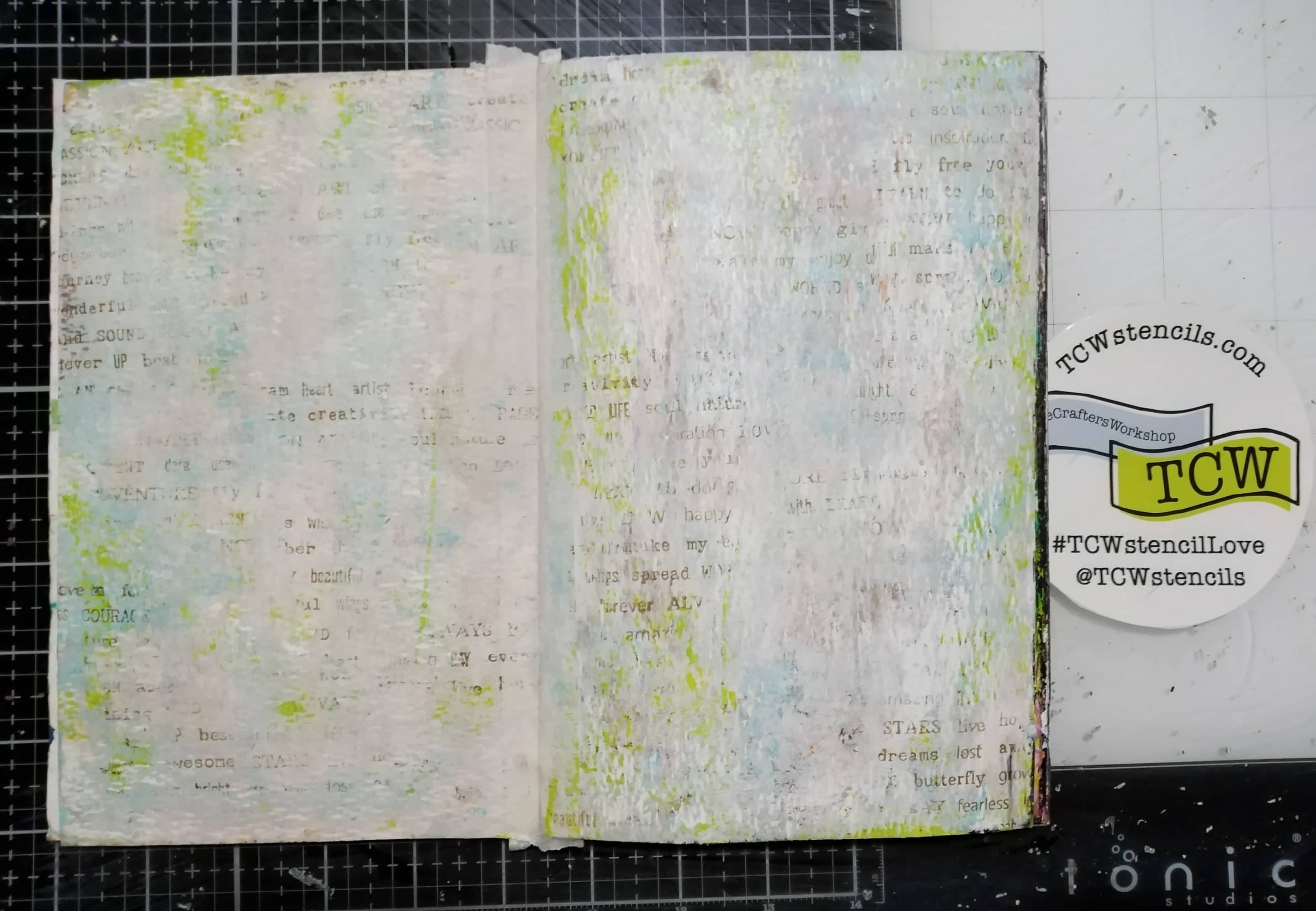 Art journal background made with acrylic paints, brayer and stamping with Archival inks.