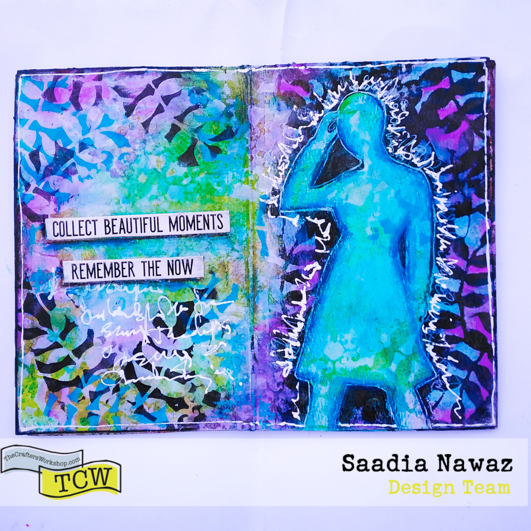 An art journal spread with acrylic paints, TCW stencils and a silhouette mask.