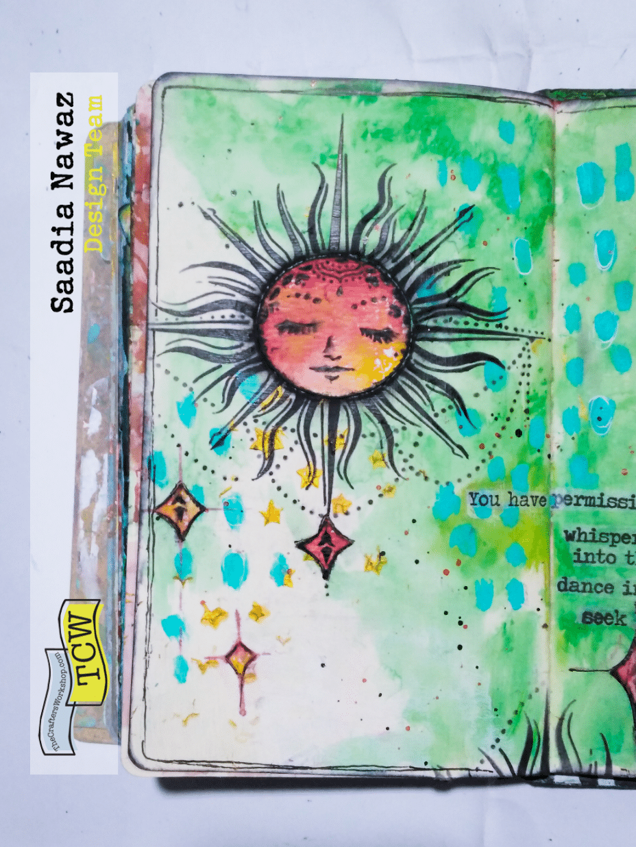 An art journal spread with The Crafters Workshop stencils, acrylic paints and modeling paste