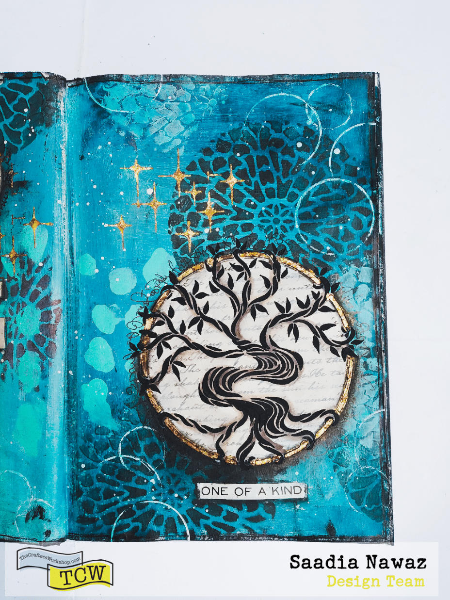Mixed media journal spread with acrylic paints, modeling pastes, gilding, stencils.