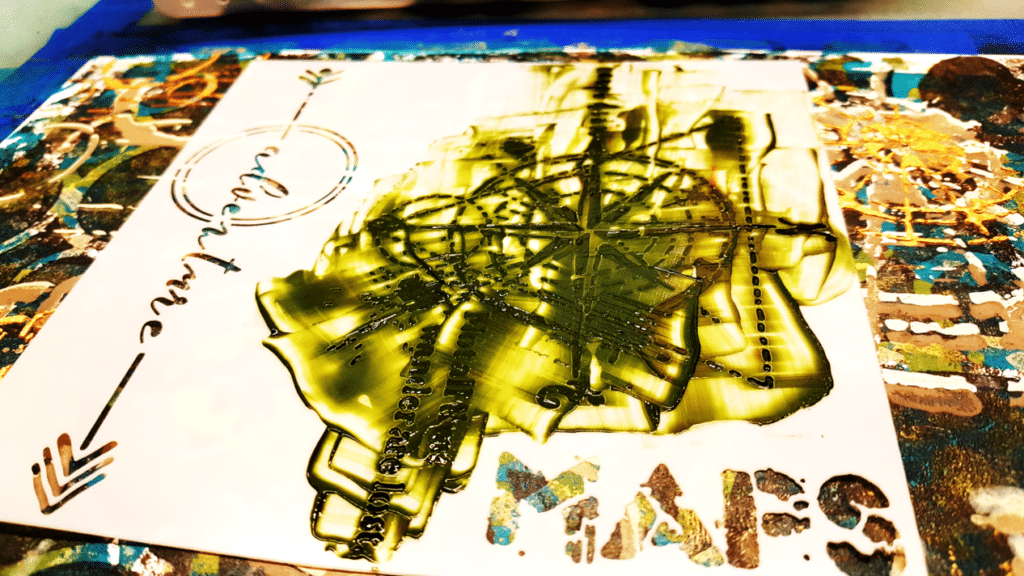 Layer 9 - close up of stencil with Olive green modeling paste applied with a palette knife.