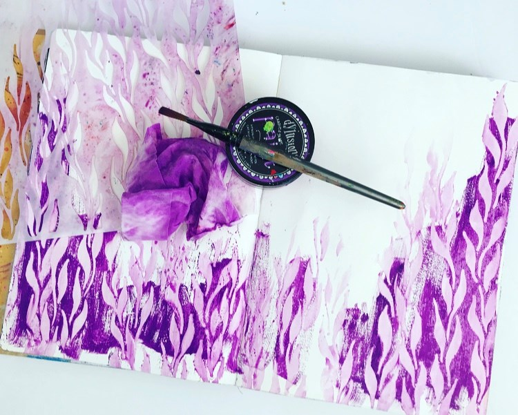 Purple paint with a stencil to create seaweed.