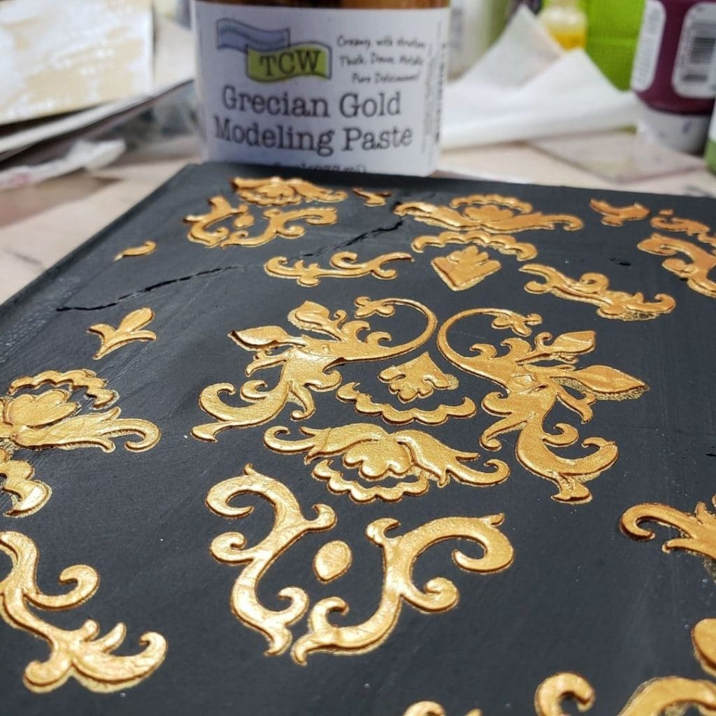 Used Damask stencil with Grecian Gold Modeling paste to the cover.