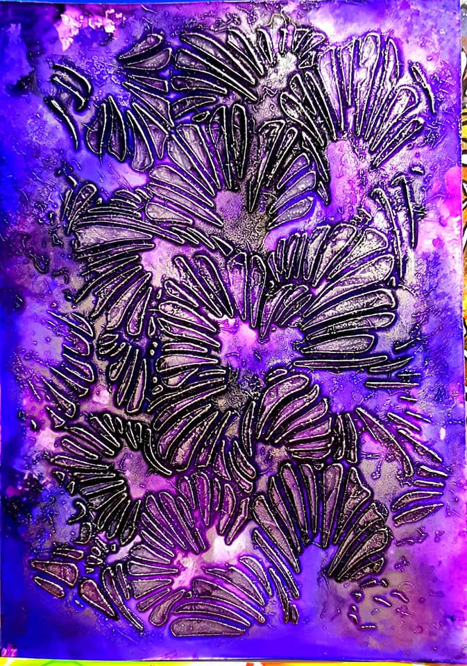 Yupo paper featuring purple and blue alcohol inks with marcasite silver modeling paste applied with a palette knife through the lush petals stencil.