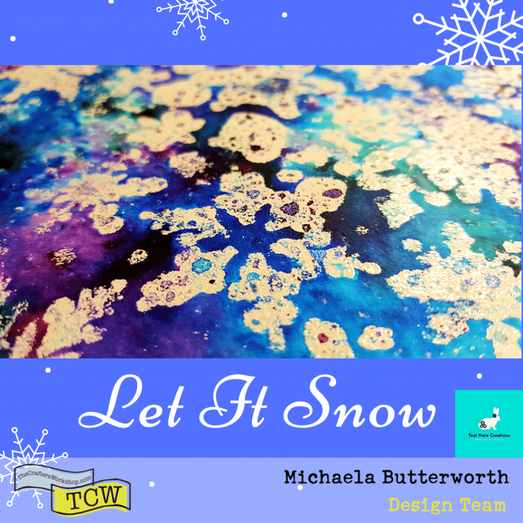 Close up image showing the white embossed snowflakes on the mixed media board, with the ColorSparx powders dried by the heat gun.